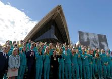 Sydney's Lord Mayor Clover Moore (C) waves with Australia's Olympic athletes returning from Rio during an official welcome ceremony at the Sydney Opera House in Australia, August 29, 2016.   REUTERS/Jason Reed