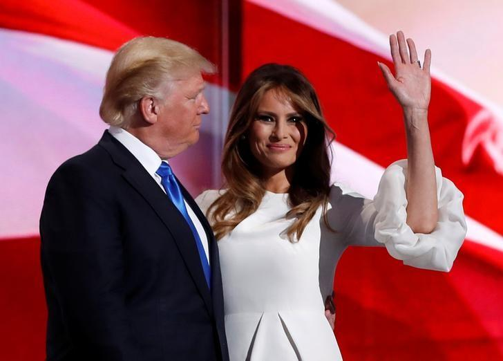 Melania Trump stands with her husband Republican U.S. presidential candidate Donald Trump at the Republican National Convention in Cleveland, Ohio, U.S. July 18, 2016. REUTERS/Mark Kauzlarich/File Photo