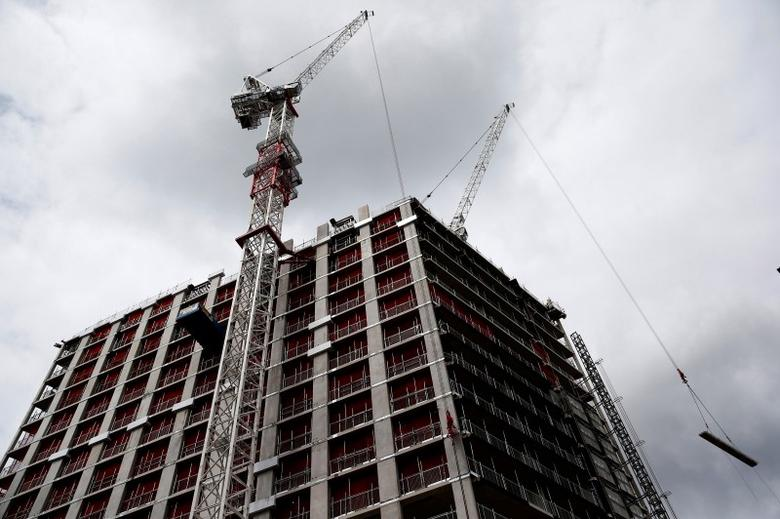 A crane towers over a building site in central London, Britain June 27, 2016. Picture taken June 27, 2016. REUTERS/Neil Hall