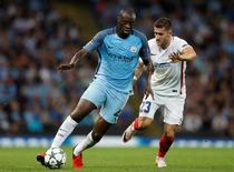 Manchester City's Yaya Toure in action with Steaua Bucharest's Ovidiu Popescu.   Action Images via Reuters / Carl Recine Livepic