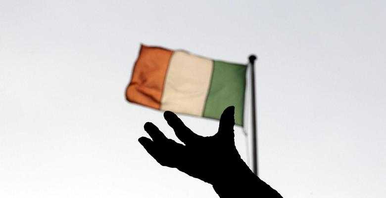Ireland's national flag flies above a statue on O'Connell Street in Dublin in this December 5, 2011 file photo. REUTERS/Cathal McNaughton/File Photo