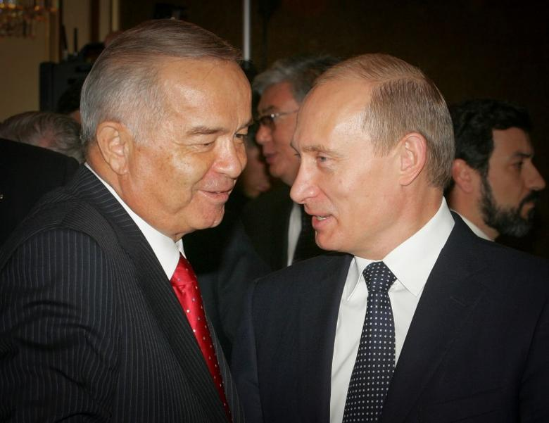 FILE PHOTO -  Uzbekistan's President Islam Karimov (R) and his Russian counterpart Vladimir Putin talk during a summit of member states of the Conference on Interaction and Confidence-Building Measures in Asia (CICA) in Almaty, Kazakhstan, June 17, 2006.  REUTERS/Shamil Zhumatov/File Photo