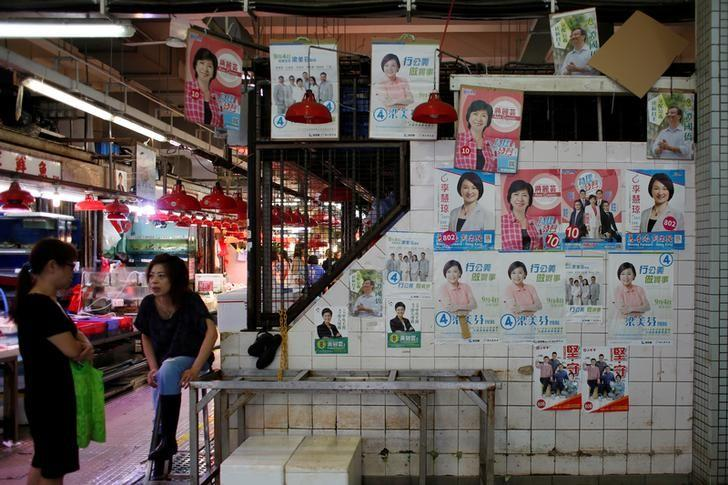 Candidates' campaign posters for the Legislative Council election are displayed at a market in Hong Kong, China August 17, 2016.    REUTERS/Bobby Yip/Files
