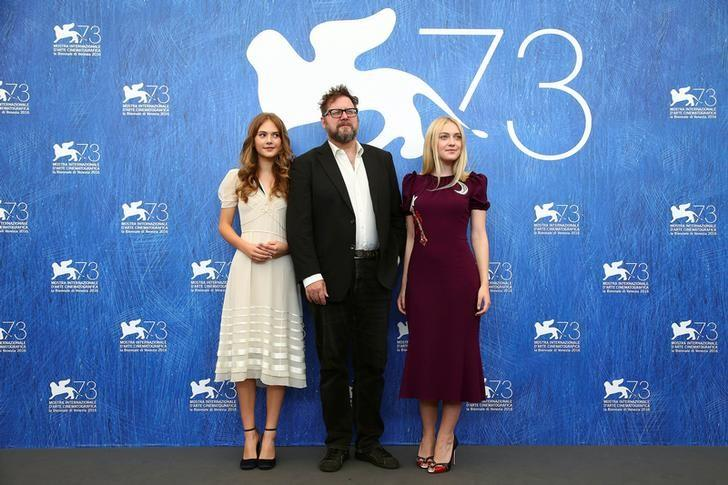 Director Martin Koolhoven poses with actresses Dakota Fanning (R) and Emilia Jones (L) as they attend the photocall for the movie ''Brimstone'' at the 73rd Venice Film Festival in Venice, Italy September 3, 2016. REUTERS/Alessandro Bianchi