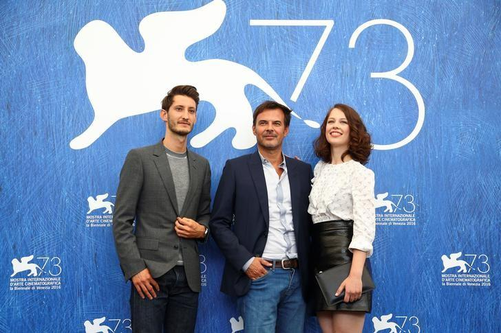Director Francois Ozon poses with actors Pierre Niney, Paula Beer as they attend the photocall for the movie ''Frantz'' at the 73rd Venice Film Festival in Venice, Italy September 3, 2016. REUTERS/Alessandro Bianchi