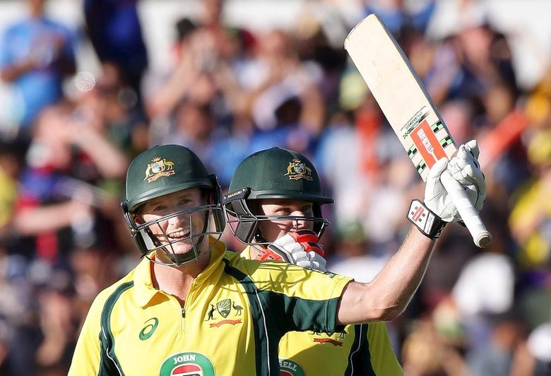 Australia's George Bailey (L) celebrates with team mate Steve Smith after making his century during the One Day International cricket match against India in Perth January 12, 2016.     REUTERS/Bill Hatto