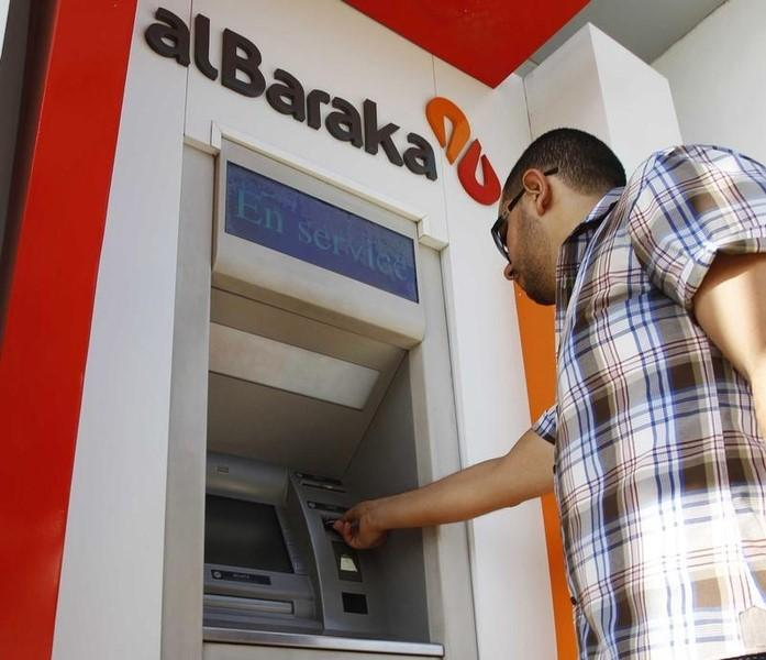 A man uses an automated teller machine (ATM) at the head office of the Islamic Bank of Al-Baraka in Tunis October 5, 2012.  REUTERS/Zoubeir Souissi