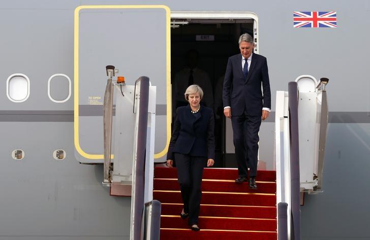 Britain's Prime Minister Theresa May (L) arrives at Hangzhou Xiaoshan international airport before G20 Summit in Hangzhou, Zhejiang Province, China, Sep 4, 2016. REUTERS/Stringer/Files