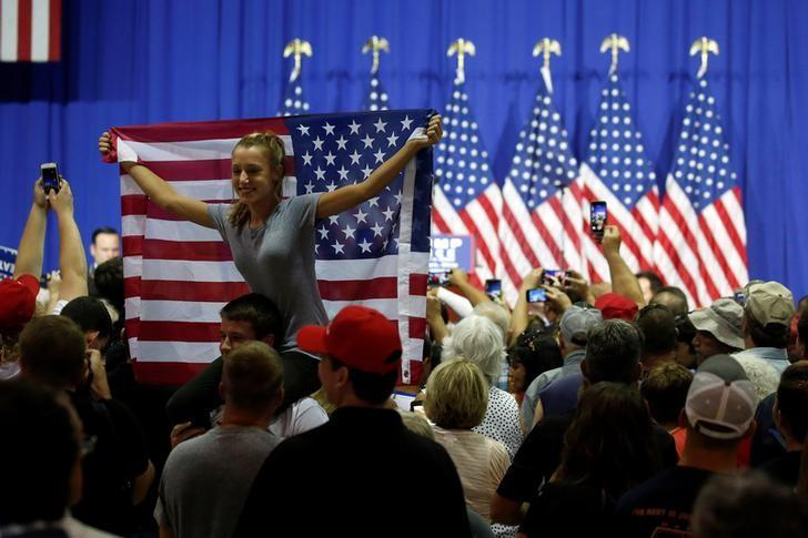People watch after U.S. Republican presidential nominee Donald Trump speaks during a campaign event in Wilmington, Ohio, U.S. September 1, 2016. REUTERS/Carlo Allegri