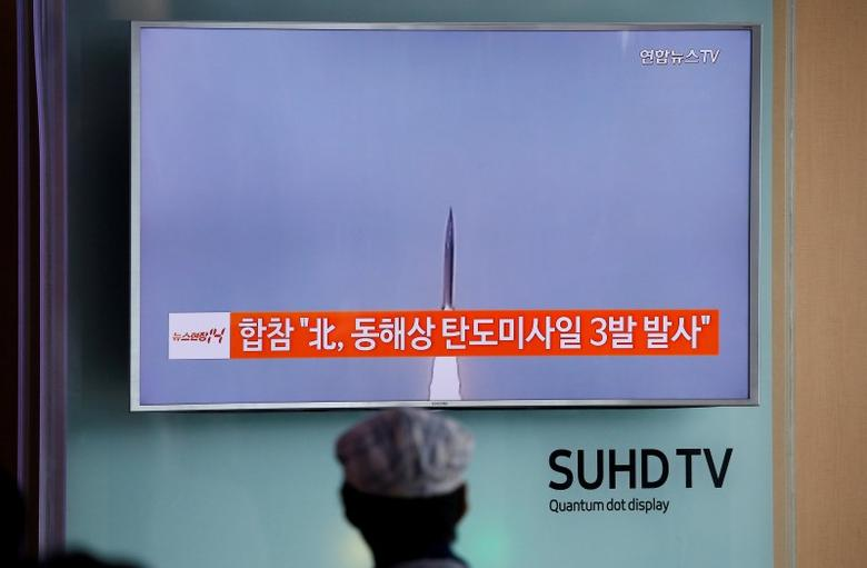 A passenger watches a TV screen broadcasting a news report on North Korea firing three ballistic missiles into the sea off its east coast, at a railway station in Seoul, South Korea, September 5, 2016.   REUTERS/Kim Hong-Ji