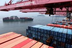A crane carries a container from a Hanjin Shipping ship at the Hanjin container terminal as a China Shipping Line ship (L) arrives at the Busan New Port in Busan, about 420 km (261 miles) southeast of Seoul, August 8, 2013.  REUTERS/Lee Jae-Won/File Photo - RTX2O4TB