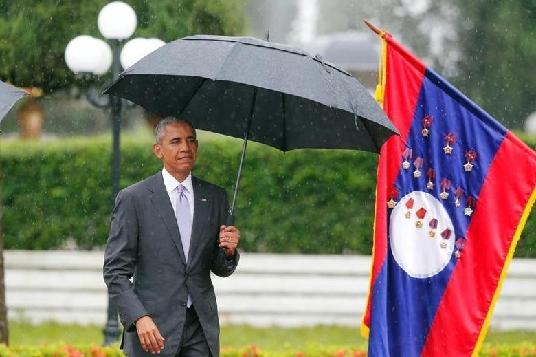 U.S. President Barack Obama walks to honour guard during a welcoming ceremony at the Presidential Palace in Vientiane, Laos September 6, 2016. REUTERS/Jorge Silva