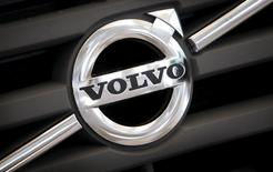The logo of Volvo is seen on the front grill of a Volvo truck in a customer showroom at the company's headquarters in Gothenburg, Sweden, September 23, 2008. REUTERS/Bob Strong/File Photo - RTSIK7P