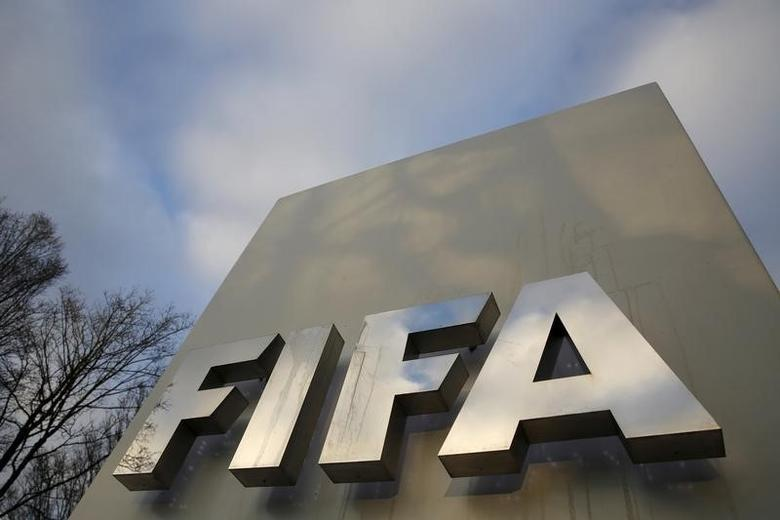 A FIFA sign is seen outside the FIFA headquarters in Zurich, Switzerland December 17, 2015. REUTERS/Ruben Sprich -