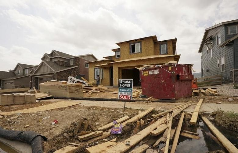 A house under construction has a sold sign out front in the Candelas development in the northwest Denver suburb of Arvada, Colorado August 18, 2015. REUTERS/Rick Wilking/Files