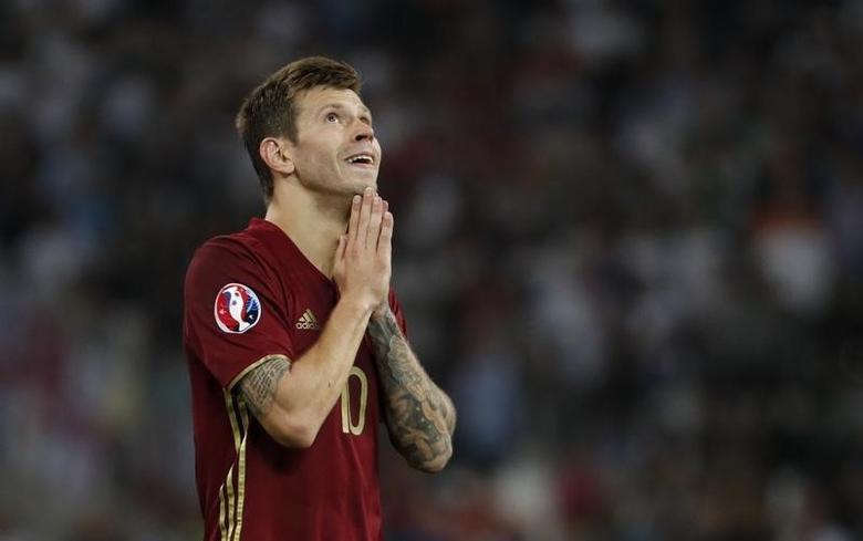 Russia's Fedor Smolov looks dejectedREUTERS/Yves HermanLivepic