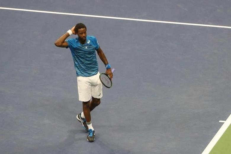 Gael Monfils of France celebrates the win against Lucas Pouille of France on day nine of the 2016 U.S. Open tennis tournament at USTA Billie Jean King National Tennis Center.  Anthony Gruppuso-USA TODAY Sports