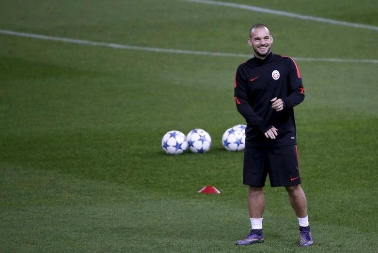 Galatasaray's Wesley Sneijder attends a training session prior to their Champions League soccer match against Atletico Madrid. REUTERS/Juan Medina