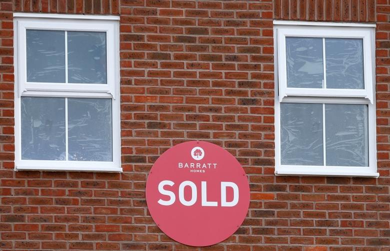 A sold sign hangs on a new house on a Barratt Homes building site in Nuneaton, Britain, March 20, 2014.    REUTERS/Darren Staples/File Photo