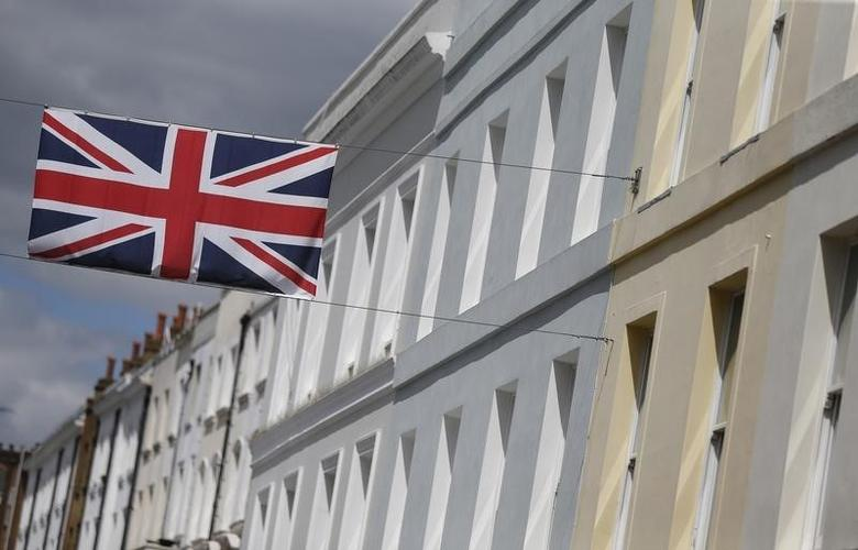 A Union flag hangs across a street of houses in London, Britain June 3, 2015.  REUTERS/Suzanne Plunkett