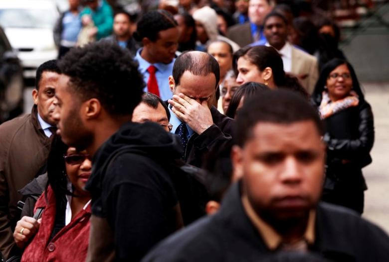 A man rubs his eyes as he waits in a line of jobseekers, to attend the Dr. Martin Luther King Jr. career fair held by the New York State department of Labor in New York April 12, 2012.    REUTERS/Lucas Jackson/File Photo
