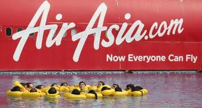 The logo of Malaysia's low-cost airline AirAsia Berhad is pictured on a structure as its staff undergo training at its academy in Sepang outside Kuala Lumpur September 13, 2013. REUTERS/Bazuki Muhammad