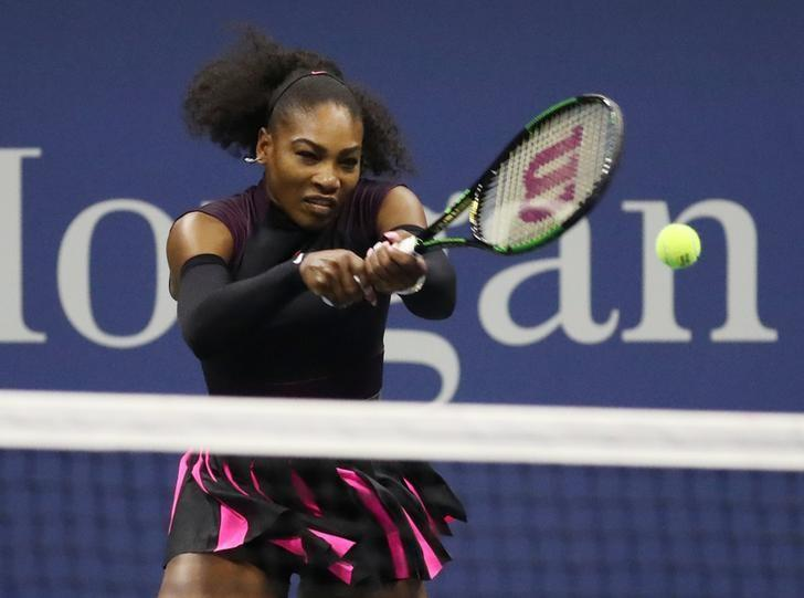 Sep 7, 2016; New York, NY, USA; Serena Williams of the United States hits a shot to Simona Halep of Romania on day ten of the 2016 U.S. Open tennis tournament at USTA Billie Jean King National Tennis Center. Mandatory Credit: Geoff Burke-USA TODAY Sports