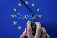 A woman hovers a mouse over the Google and European Union logos in this April 15, 2015 photo illustration.  REUTERS/Dado Ruvic/Illustration/File Photo