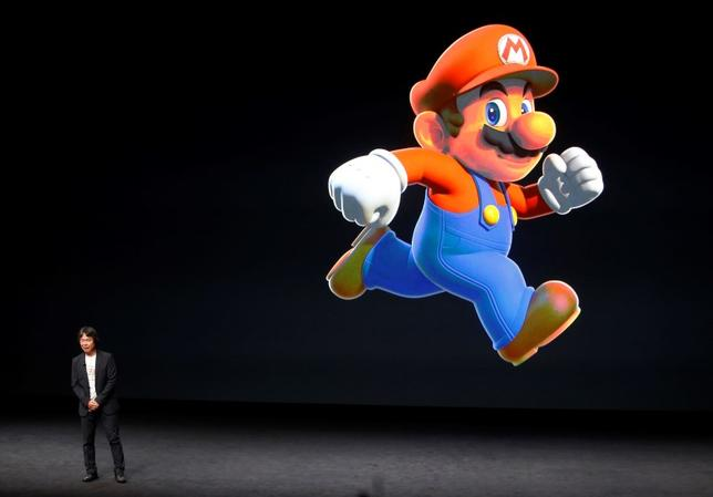 Nintendo Creative Fellow Shigeru Miyamoto stands next to the Super Mario character during an Apple media event in San Francisco, California, U.S. September 7, 2016.  REUTERS/Beck Diefenbach