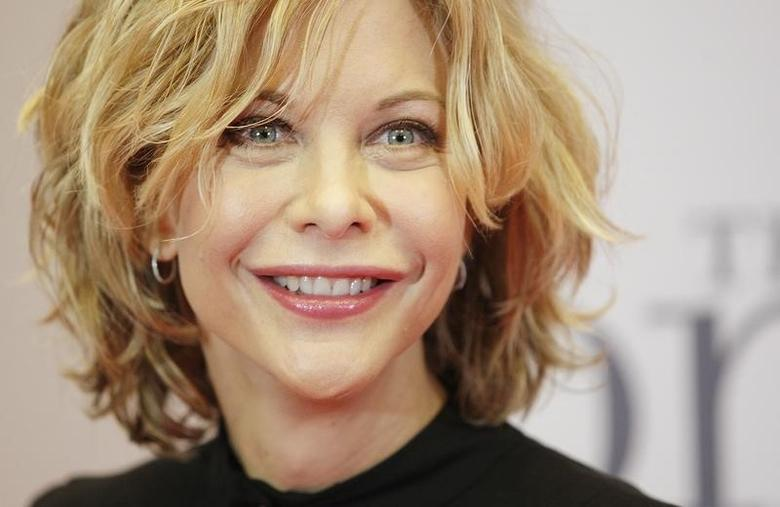 U.S. actress Meg Ryan poses for media to present her new film ''The Women'' in Berlin November 26, 2008. REUTERS/Hannibal Hanschke/Files