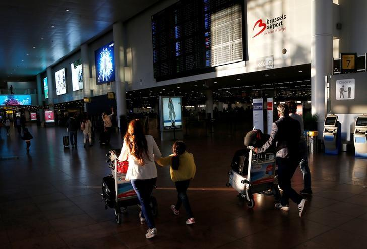 Passengers walk in the departure hall at Zaventem international airport near Brussels, Belgium, August 10, 2016.    REUTERS/Francois Lenoir/File Photo