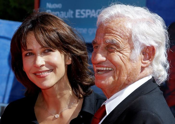 Actor Jean-Paul Belmondo (R) and actress Sophie Marceau (L) pose on the red carpet before the Ceremony of Golden Lion award for lifetime achievement at the 73rd Venice Film Festival in Venice, Italy September 8, 2016. REUTERS/Alessandro Bianchi