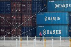 A man stands in front of shipping containers at the Hanjin Shipping container terminal at Incheon New Port in Incheon, South Korea, September 7, 2016.   REUTERS/Kim Hong-Ji