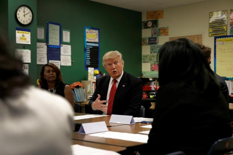 Republican presidential nominee Donald Trump meets with teachers, students and local officials during a campaign visit to the Cleveland Arts and Social Sciences Academy in Cleveland, Ohio, U.S., September 8, 2016.  REUTERS/Mike Segar