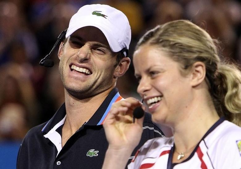 Andy Roddick of the U.S and Kim Clijsters of Belgium laugh during a fundraising exhibition ''Hit for Haiti'' for the victims of the Haiti earthquake ahead of the Australian Open tennis tournament in Melbourne January 17, 2010.   REUTERS/Mick Tsikas/Files