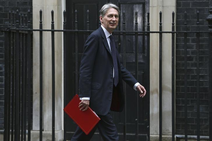 Britain's Chancellor of the Exchequer Philip Hammond arrives for a meeting at Number 10 Downing Street in London, Britain August 2, 2016. REUTERS/Neil Hall