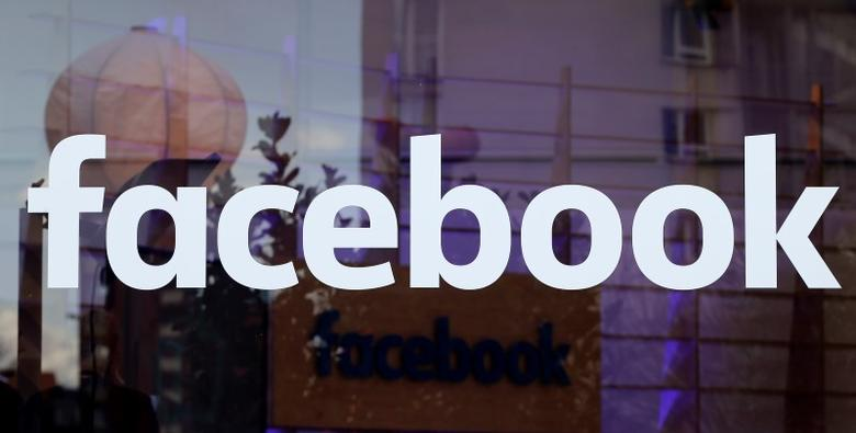 The logo of Facebook is pictured on a window at new Facebook Innovation Hub during a media tour in Berlin, Germany, February 24, 2016.      REUTERS/Fabrizio Bensch