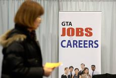 File photo of a woman walking through the 2014 Spring National Job Fair and Training Expo in Toronto, April 3, 2014. REUTERS/Aaron Harris/File Photo