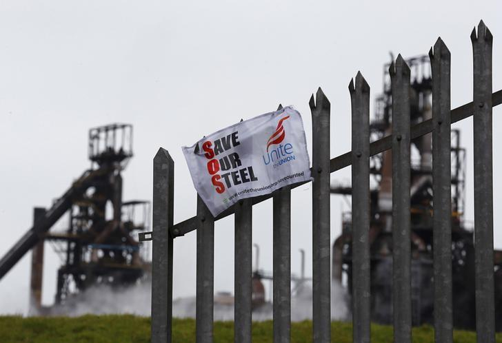 File photograph shows a union banner hanging from a fence in front of the Tata steelworks in the town of Port Talbot, Wales, Britain in this April 1, 2016 file photo. REUTERS/Darren Staples/Files