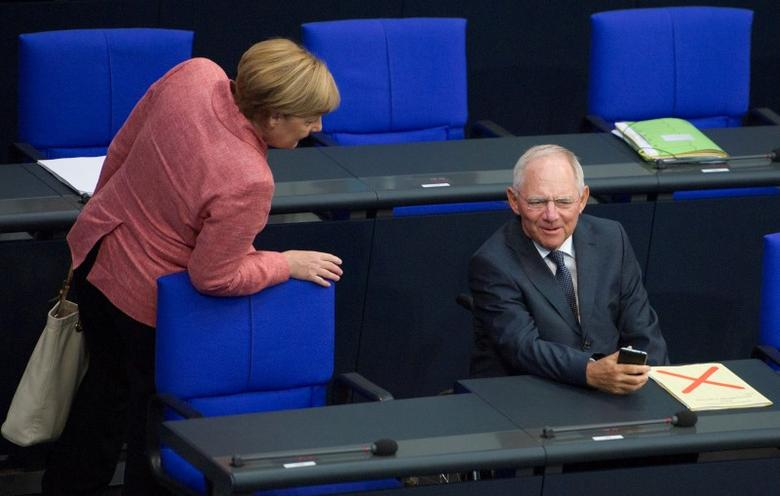 German Finance Minister Wolfgang Schaeuble and Chancellor Angela Merkel attend a meeting at the lower house of parliament Bundestag on 2017 budget in Berlin, Germany, September 6, 2016. REUTERS/Stefanie Loos