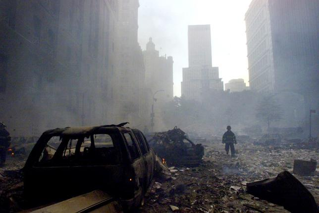 FILE PHOTO - A firefighter walks amid rubble near the base of thedestroyed World Trade Center in New York on September 11, 2001.REUTERS/Peter Morgan