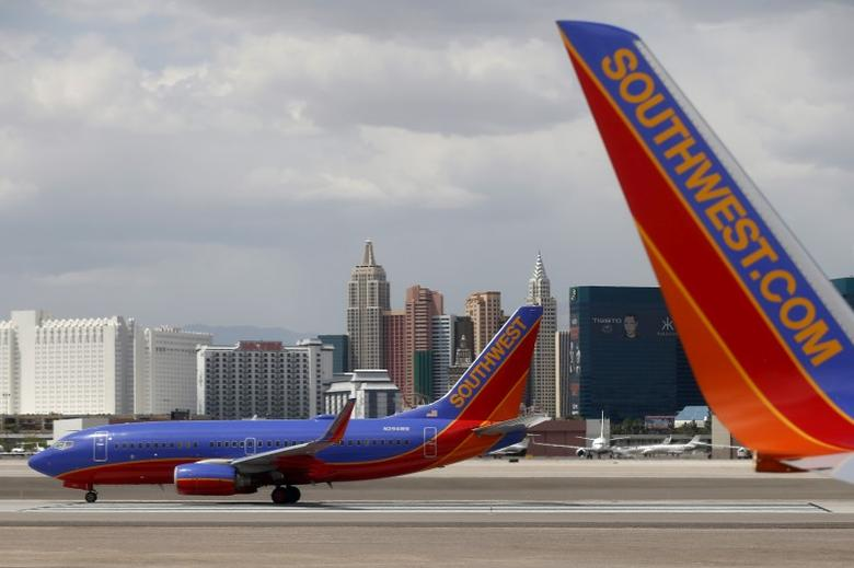 Southwest Airlines planes are seen in front of the Las Vegas strip, Nevada, United States April 23, 2015. REUTERS/Lucy Nicholson/File Photo