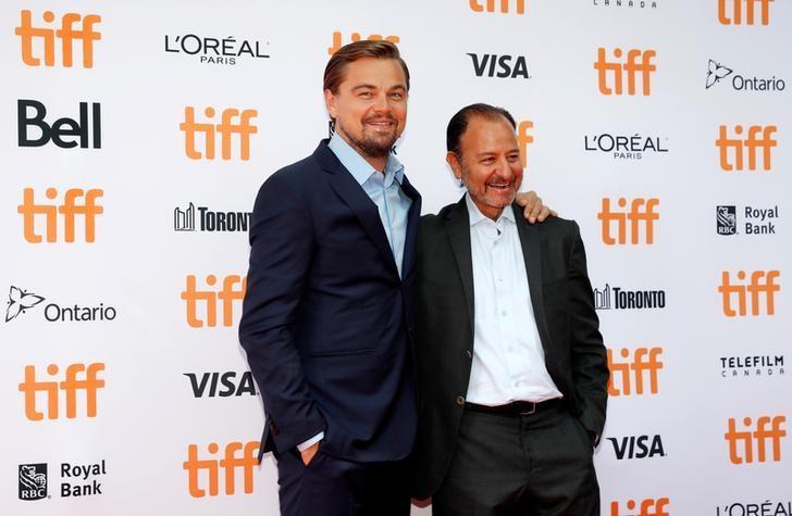 Leonardo DiCaprio arrives on the red carpet with Fisher Stevens (R) for the film ''Before the Flood'' during the 41st Toronto International Film Festival (TIFF), in Toronto, Canada, September 9, 2016.    REUTERS/Mark Blinch