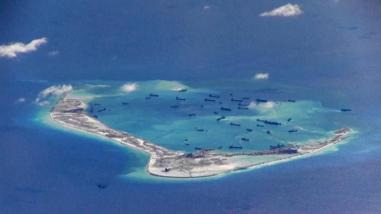 Chinese dredging vessels are purportedly seen in the waters around Mischief Reef in the disputed Spratly Islands in the South China Sea in this still image from video taken by a P-8A Poseidon surveillance aircraft provided by the United States Navy May 21, 2015. U.S. Navy/Handout via Reuters/File Photo
