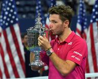 Sept 11, 2016; New York, NY, USA;   Stan Wawrinka of Switzerland celebrates with the championship trophy after beating Novak Djokovic of Serbia in the men's singles final on day fourteen of the 2016 U.S. Open tennis tournament at USTA Billie Jean King National Tennis Center. Mandatory Credit: Robert Deutsch-USA TODAY Sports