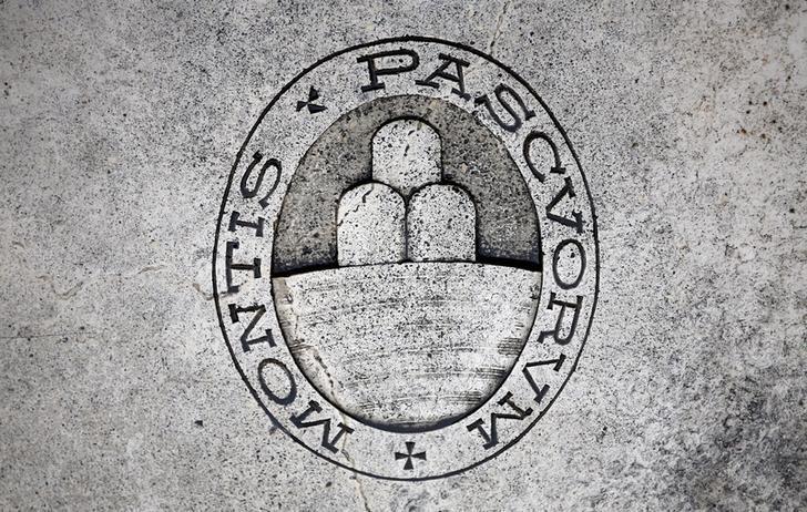 A logo of Monte dei Paschi di Siena bank is seen on the ground in Siena, Italy, November 5, 2014. REUTERS/Giampiero Sposito/File Photo  - RTX2ORXD