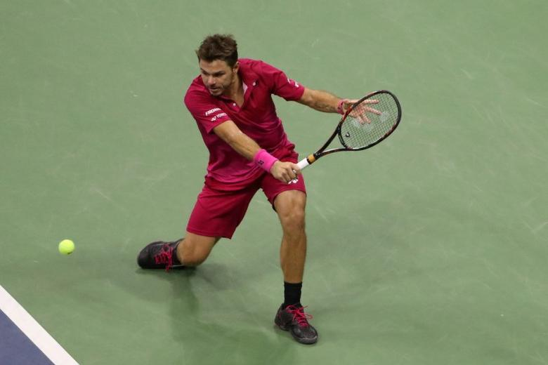 Sep 11, 2016; New York, NY, USA; Stan Wawrinka of Switzerland returns for the win against to Novak Djokovic of Serbia in four sets in the championship match on day fourteen of the 2016 U.S. Open tennis tournament at USTA Billie Jean King National Tennis Center. Mandatory Credit: Anthony Gruppuso-USA TODAY Sports