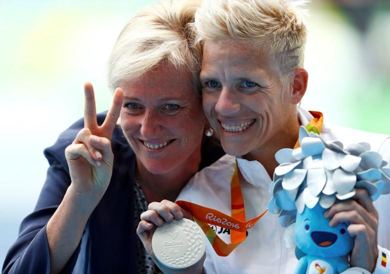 2016 Rio Paralympics - Women's 400m - T52 Final - Olympic Stadium - Rio de Janeiro, Brazil - 10/09/2016. Queen Mathilde of Belgium poses with Marieke Vervoort of Belgium as she celebrates with her silver medal during the presentation ceremony.   REUTERS/Jason Cairnduff