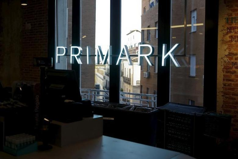 The Primark logo can be seen on windows at Primark's new Spanish flagship store in Madrid, Spain, October 15, 2015. REUTERS/Andrea Comas
