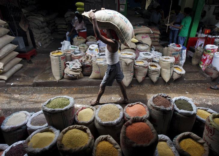 A labourer carries a sack filled with pulses at a wholesale pulses market in Kolkata, July 31, 2015. REUTERS/Rupak De Chowdhuri/Files